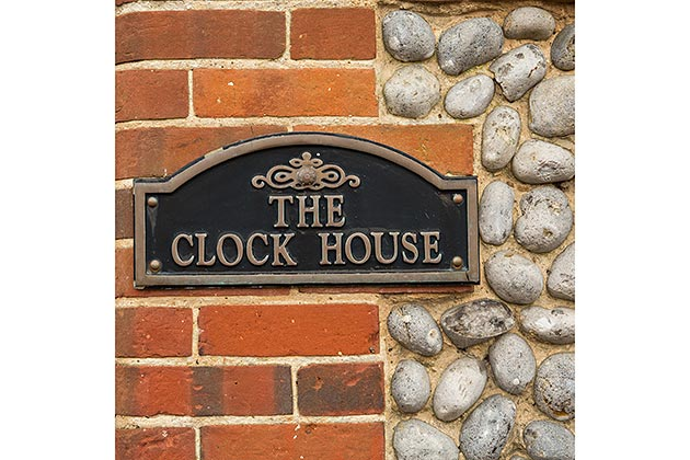 The Clock House's nameplate