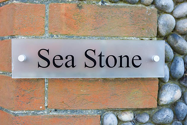 Sea Stone Cottage's nameplate