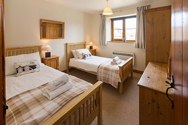Stable End Cottage's twin bedroom
