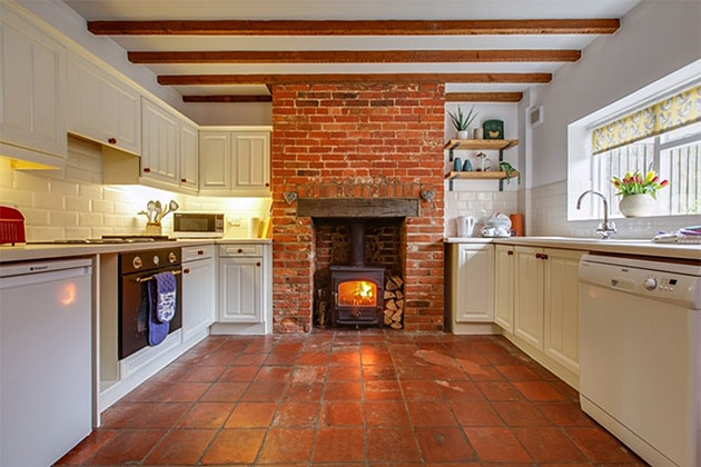 China Cottage's kitchen with wood burner