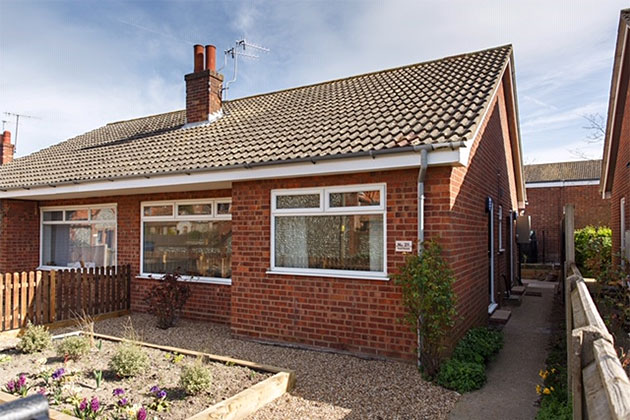 No. 21 exterior view, a lovely, light, 2-bedroom bungalow with great space for 3 people
