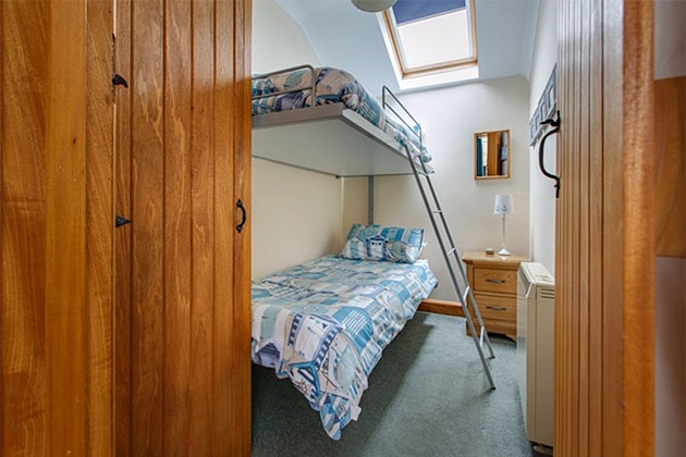 Plover Cottage's bedroom with bunk beds
