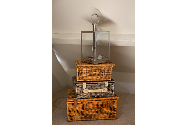 Tractor Cottage's lounge, stacked baskets