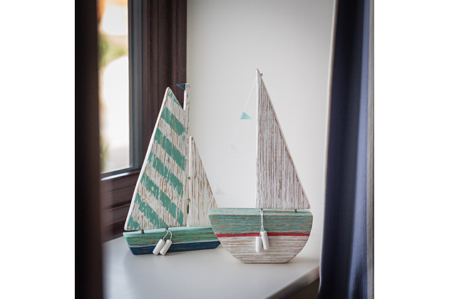 Tractor Cottage's double bedroom, sailing boat models in window