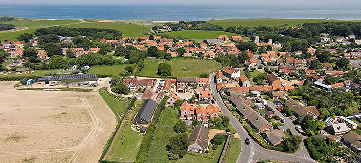 Aerial view of Home Farm Holiday Cottages looking over Weybourne to the sea