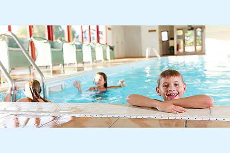 Children enjoying the indoor heated swimming pool at Home Farm cottages