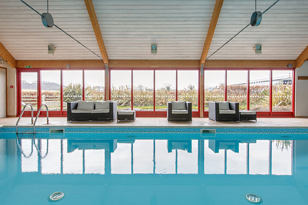 Indoor Heated Swimming Pool looking across to the fields, Home Farm Holiday Cottages