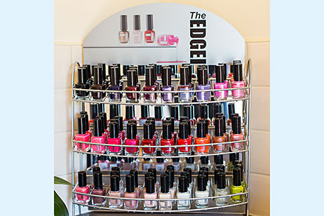 Display stand of bottles of The Edge nail colours